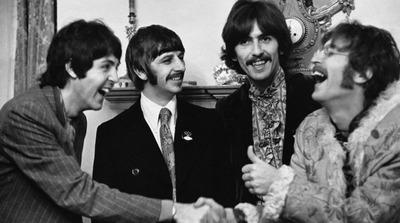 Paul and John shaking hands by Linda