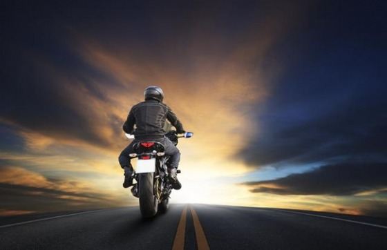 bigstock-young-man-riding-big-bike-moto-65586733