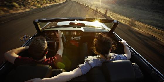 o-COUPLE-DRIVING-AWAY-IN-A-CAR-facebook