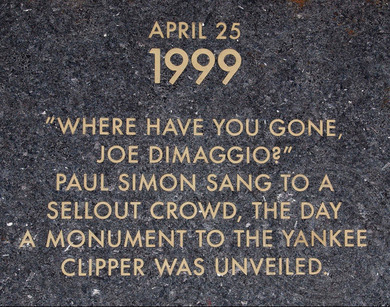 Plaque at Ruppert Plaza commemorates Paul Simon in 1999.