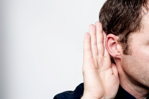 man-hand-to-ear-listening