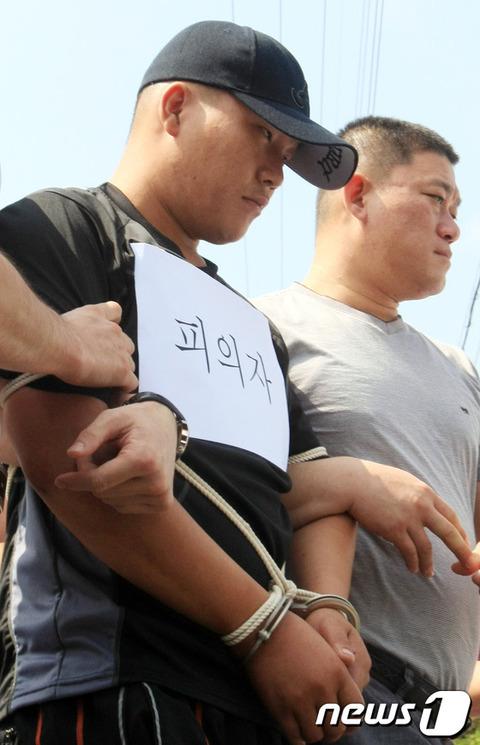 コ・ジョンソク被告、いかにも韓国塵って顔ですね