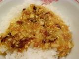 生卵と自家製食べるラー油を混ぜ混ぜ円