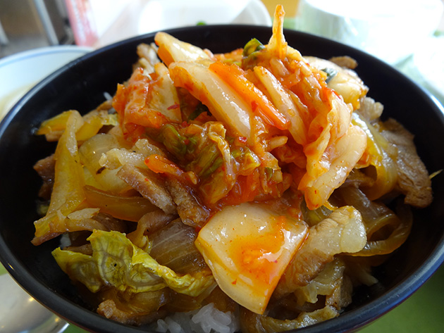 Stir-Fried Pork and Kimchi with Korean Spicy Sauce on the Rice