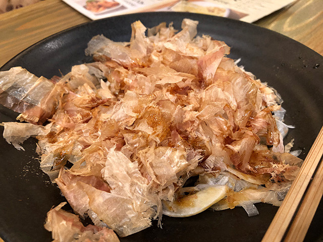Sliced Onion with Dried Bonito Flakes and Egg Yolk