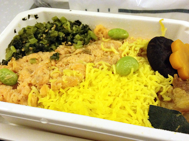 Salmon Flakes and Various Ingredients on Steamed Rice