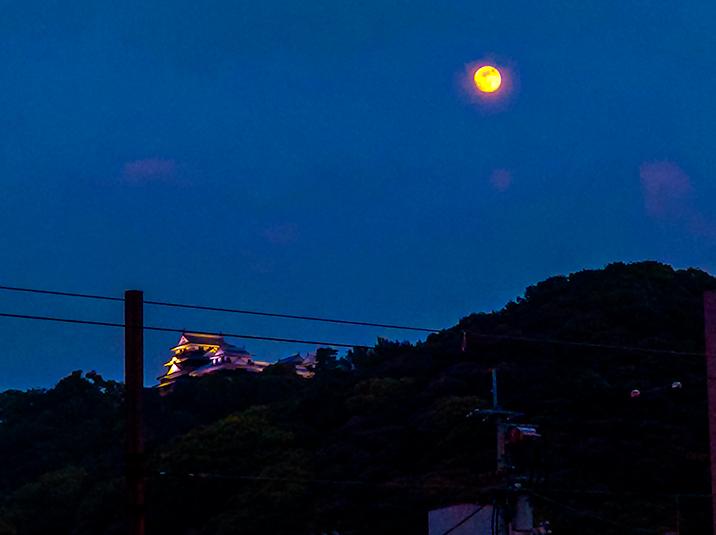 The moon and Matsuyama Castle