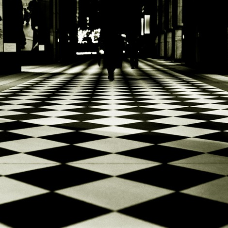 「A woman walking in a checkerboard pattern」