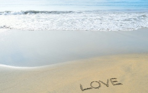 Love-Word-Written-on-Beach-Sand-600x375