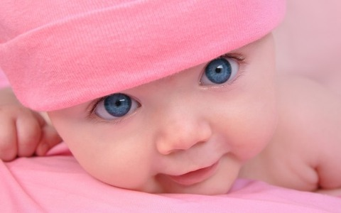 Baby-in-Pink-with-Blue-Eyes-600x375