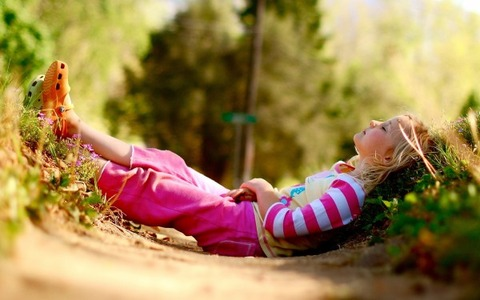 Young-Child-Relaxing-in-the-Garden-600x375