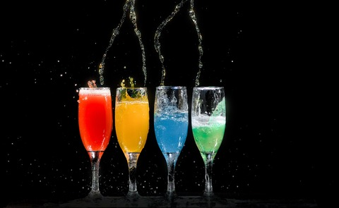 four-champagne-flutes-with-assorted-color-liquids-1028637