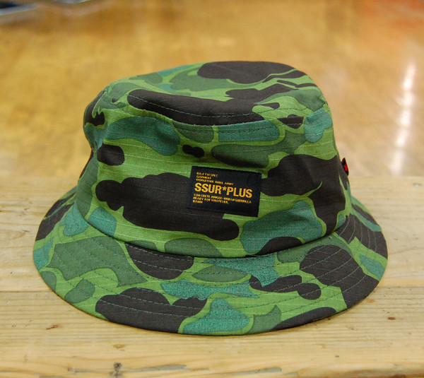52ebf18a02c SSUR PLUS DUCK CAMO BUCKET   ¥6.200+税