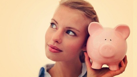 beautiful-young-woman-holding-pig-bank-696x392