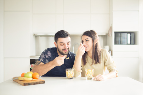 bigstock-Young-lovely-couple-eating-fru-118963937