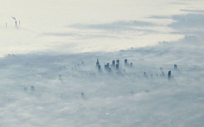 warsaw-poland-covered-in-fog-from-an-airplane-aerifal-from-above