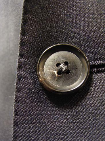 仕立て服のボタン