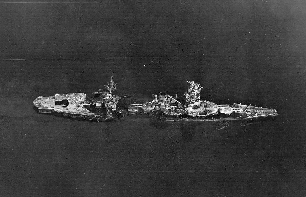 Aerial_photo_of_battleship_Hyuga_after_being_sunk_at_Kure