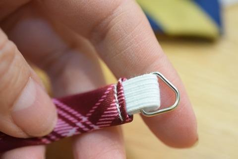 縫いとめる