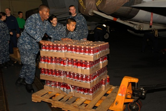 75572-sailors-unload-cases-of-drinks-and-water