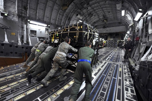 75568-airmen-load-supplies-in-california-for-japan
