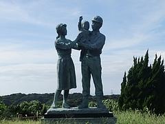 崎戸町歴史民俗資料館前に立つ炭鉱夫像