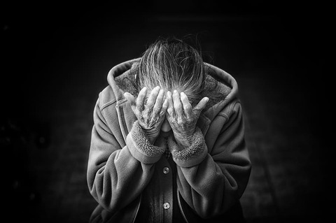 grayscale-photography-of-person-covering-face