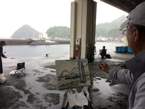 淡島の絵を描く紳士