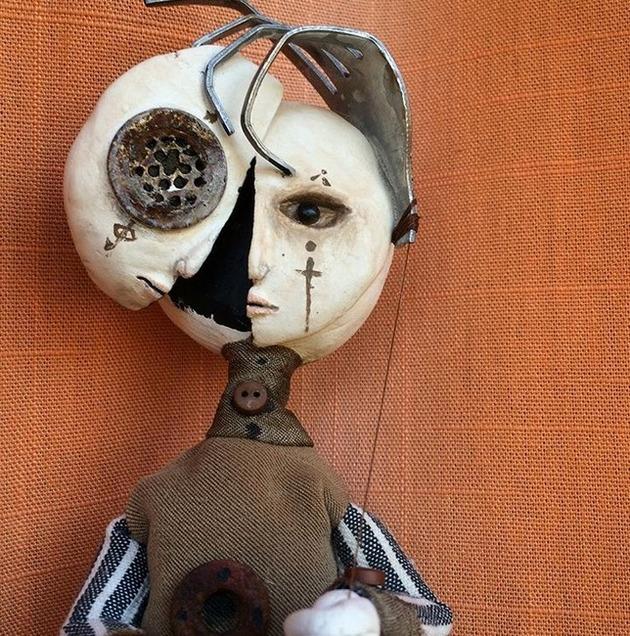 カナダの少年の人形芸術 (6)