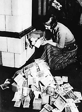 Weimar-Republic-Lady-Using-Money-To-Heat-Home-1923