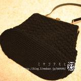 黒の編み編みがまぐちバッグ
