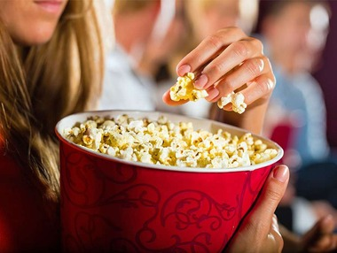 Woman-container-popcorn-cinema-movie-theater