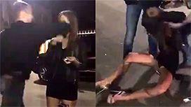 女性の顔面を殴る男の映像