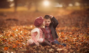 baby-kiss-girl-and-boy-autumn-leaves-photo-image-694x417