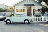vintage-car-in-front-of-houses