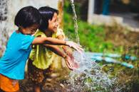 happy-and-smiling-children-playing-with-waters