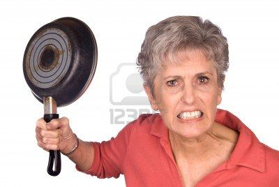 4864102-an-angry-mother-threatens-to-swing-her-frying-pan-is-a-display-of-violent-behavior-image-was-shot-ag[1]