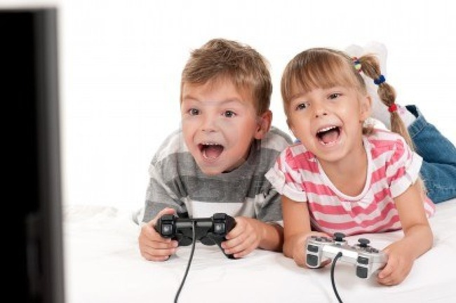 10843226-happy-children--girl-and-boy-playing-a-video-game