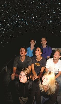 WCC people and boat looking at glowworms