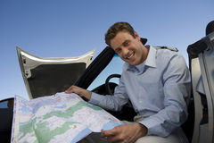 man-holding-map-sitting-car-29651034