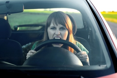biting-steering-wheel-woman-driver
