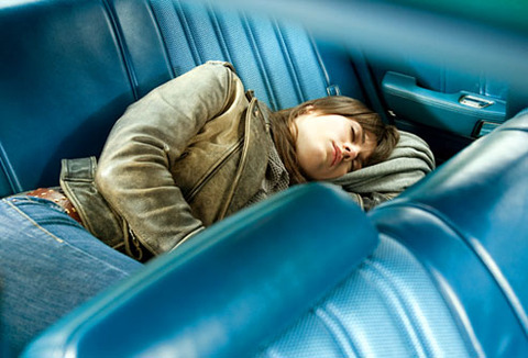 getty_rf_photo_of_woman_napping_on_car_seat