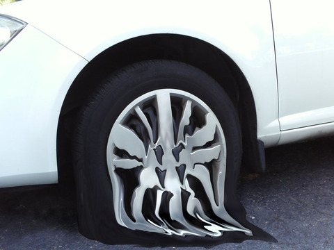 melting_tire_by_sammiseldowitz