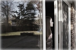 standing_in_door