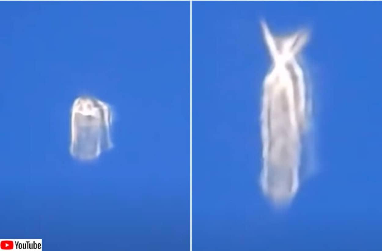 飛行機の窓から撮影した変形する謎の物体