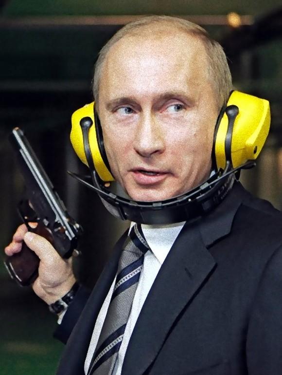 ピストルを握るプーチン大統領
