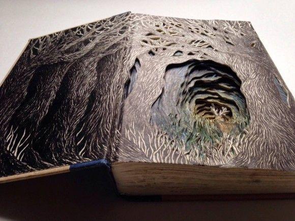 古本や捨てられていた本が立体彫刻となってよみがえる。表紙をめくると奥深きファンタジーの世界が広がっていた。