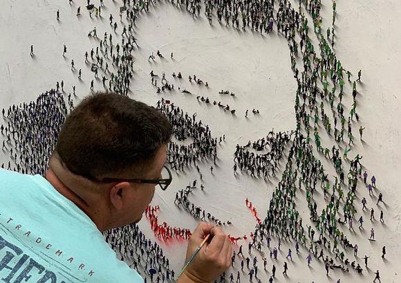 人が集まって作る「人文字」みたいに、立体的にたくさんの人を描いて作り上げる素晴らしい点画