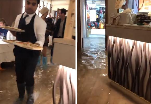 ヴェネチアで大洪水発生。だがピザ屋は浸水する店で商売を再開。んでお客も食べにくるっていう(イタリア)
