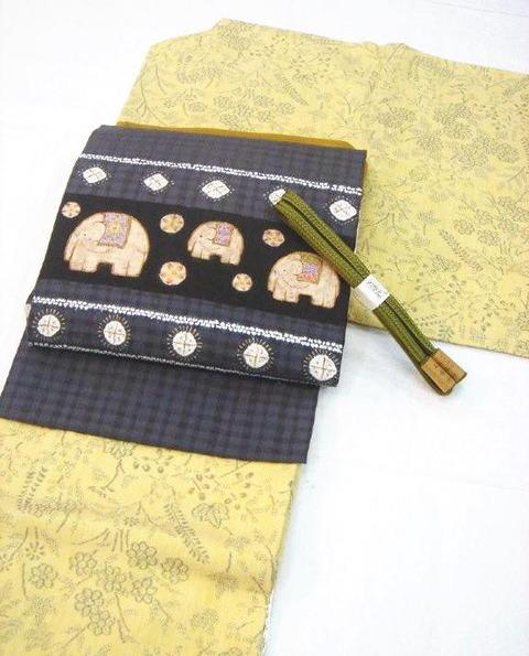 亀甲と花の絣 本場結城紬 100亀甲、絞りと型絵染紬名古屋帯